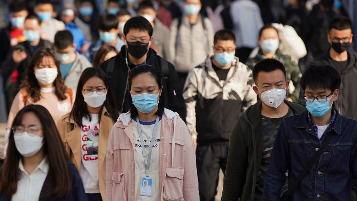 commuters in china wearing protective masks