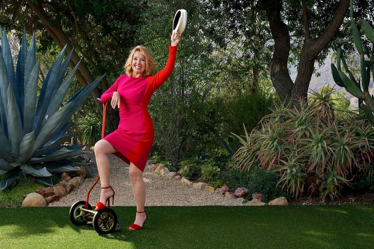 Melody Thomas Scott of The Young and the Restless in a red dress with red heels