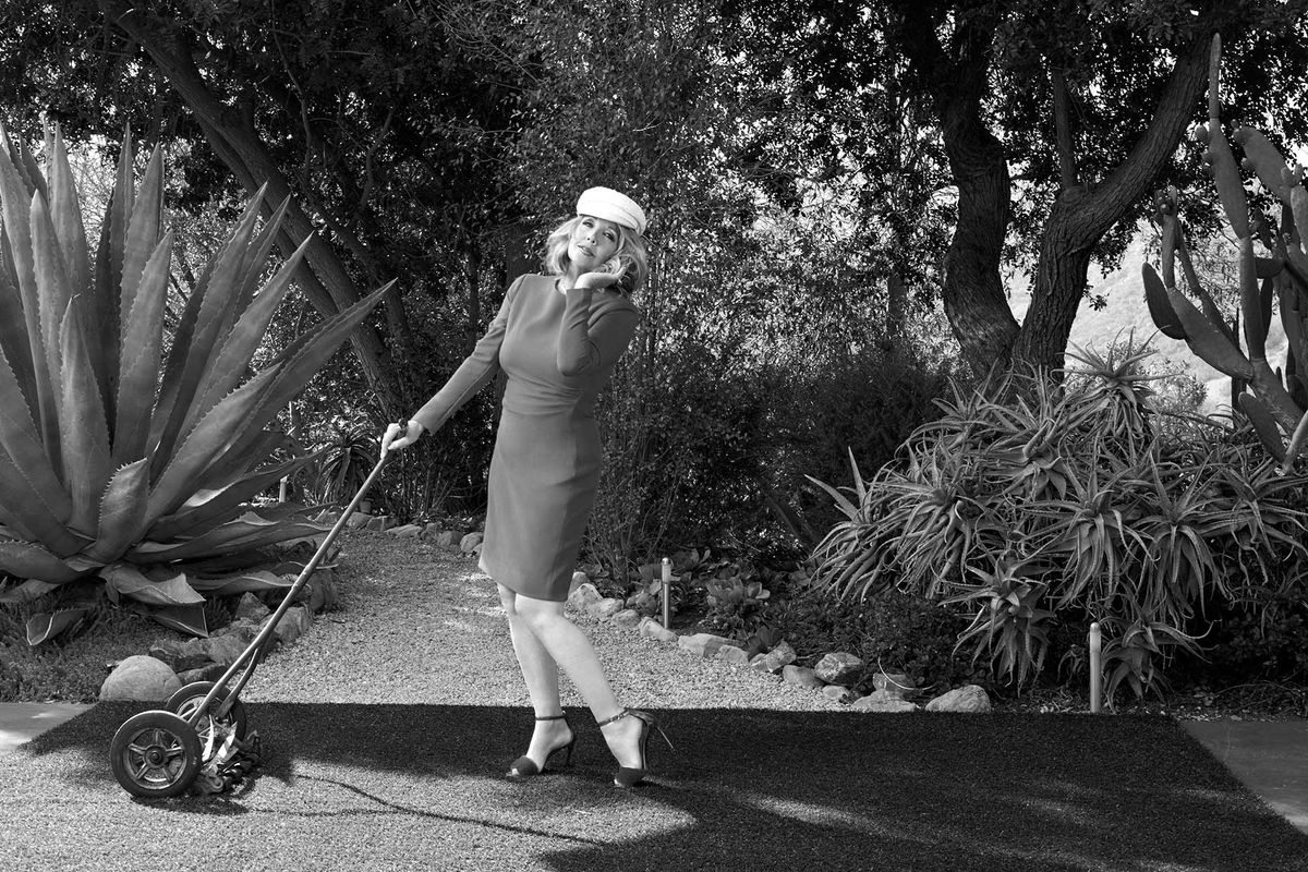 Melody Thomas Scott of The Young and the Restless pretending to use an old fashioned lawn mower