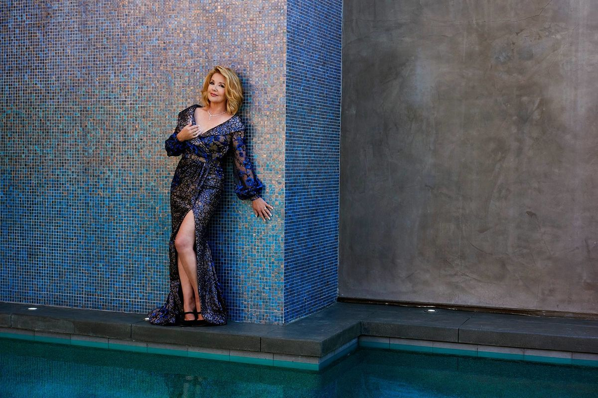 Melody Thomas Scott of The Young and the Restless in a blue embellished gown with a high slit