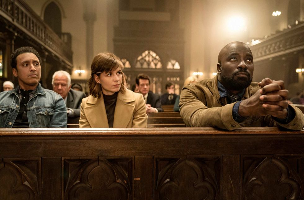 Actors Aasif Mandvi, Katja Herbers, and Mike Colter in a church.
