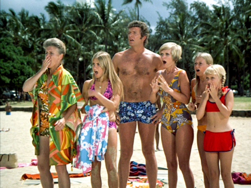 The cast of The Brady Bunch on the beach.