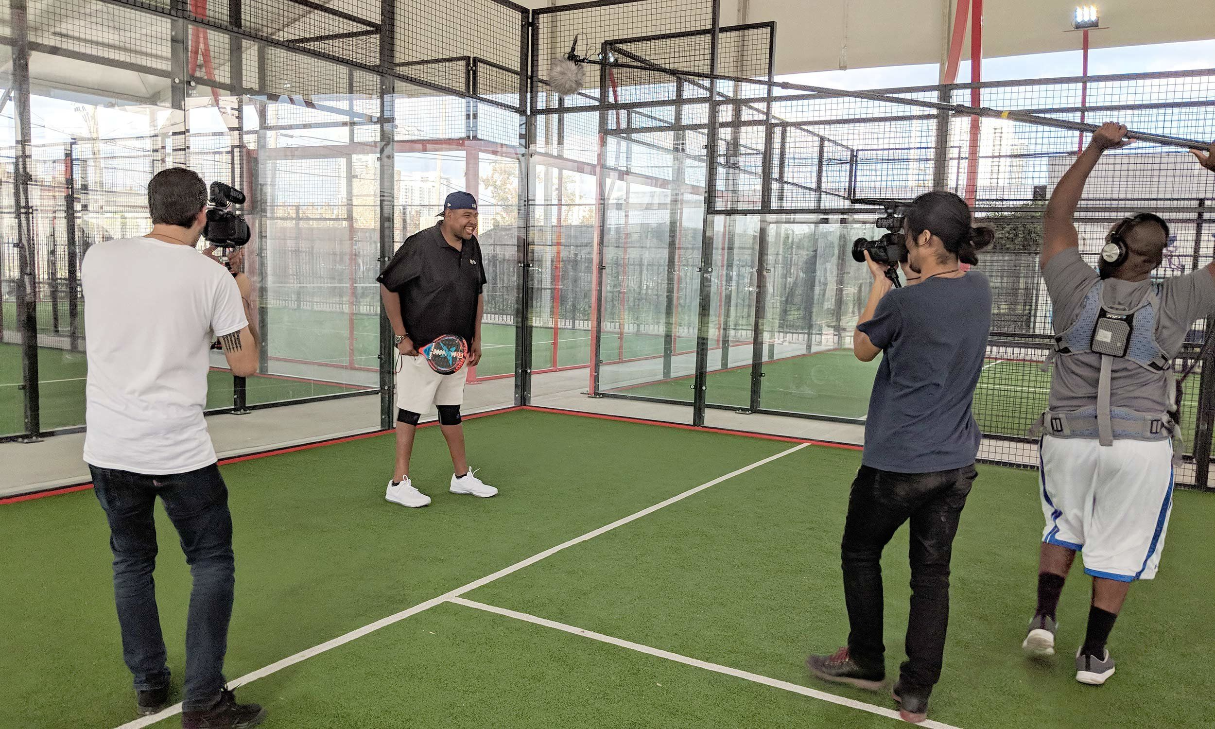Actor Omar Miller on a squash court for a video/photo shoot.