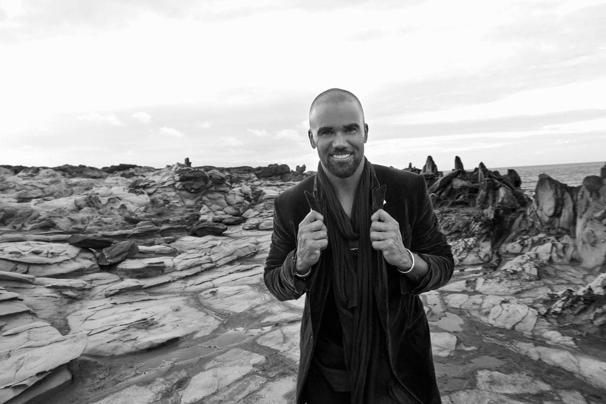 Shemar Moore in front of rocky terrain