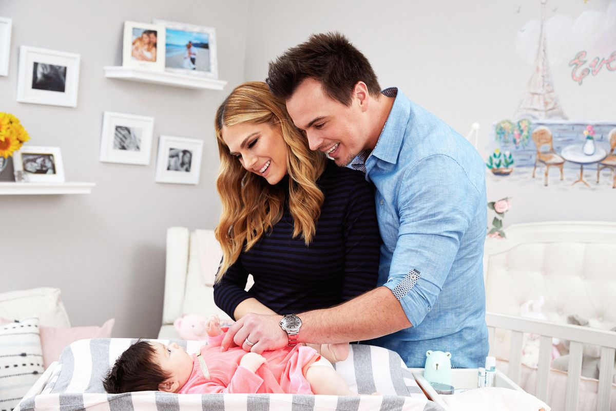 Soap stars Darin Brooks and Kelly Kruger in a nursery with their newborn baby.