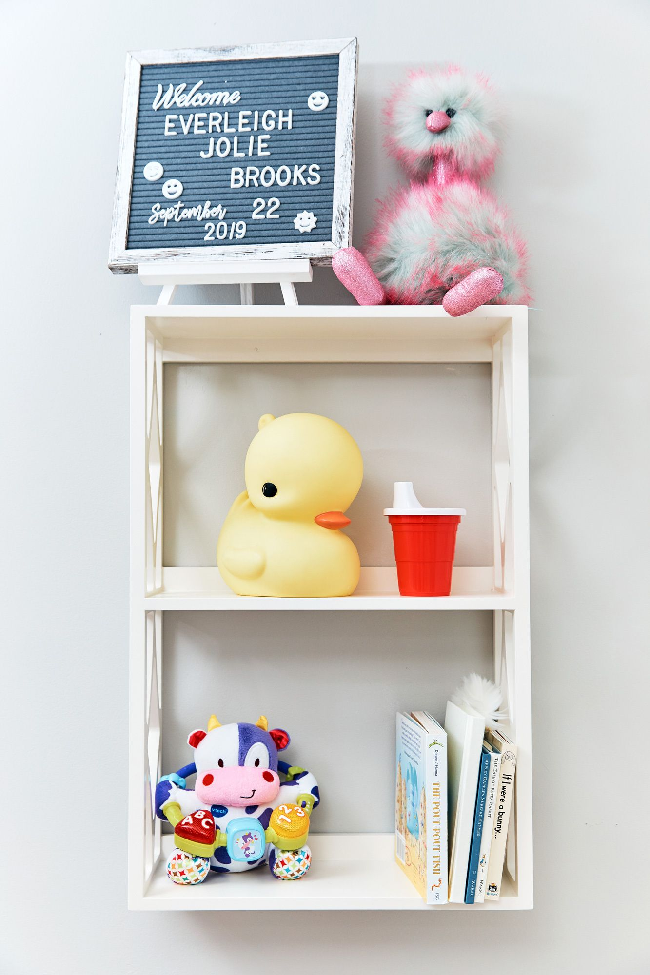 Toys and books decorating a new nursery