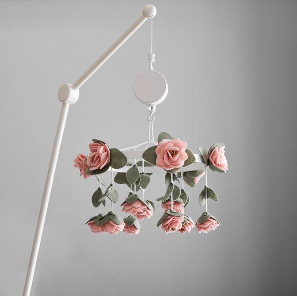 Felt rose musical mobile for a crib