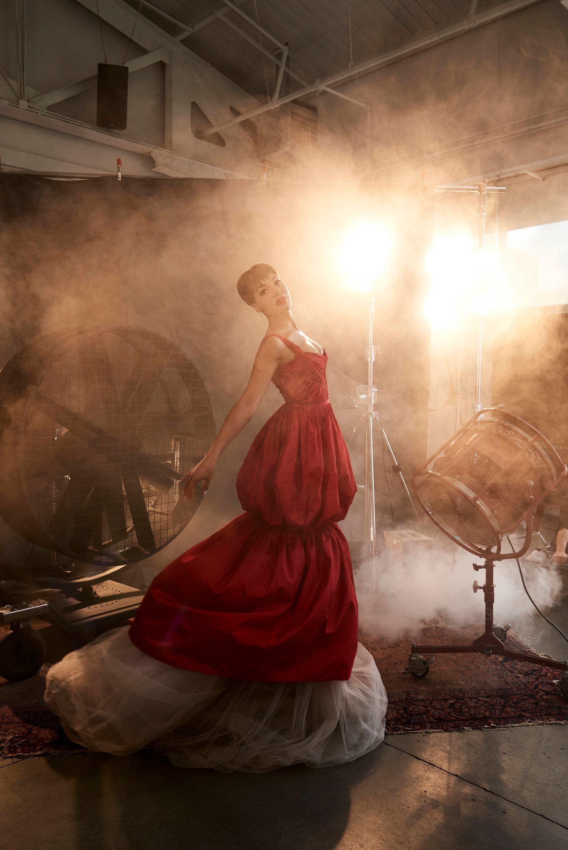 Actress Cush Jumbo posing in red designer gown.