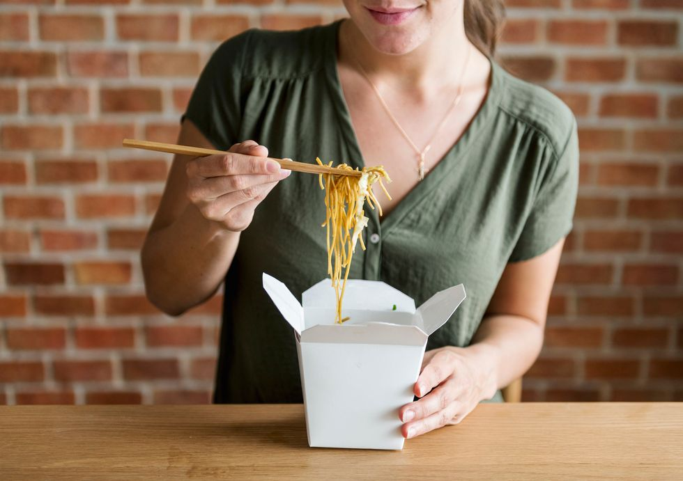 White woman eating Chow mein