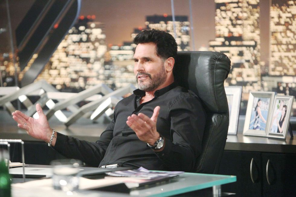 Don Diamont sitting at his office desk on the set of The Bold and the Beautiful.