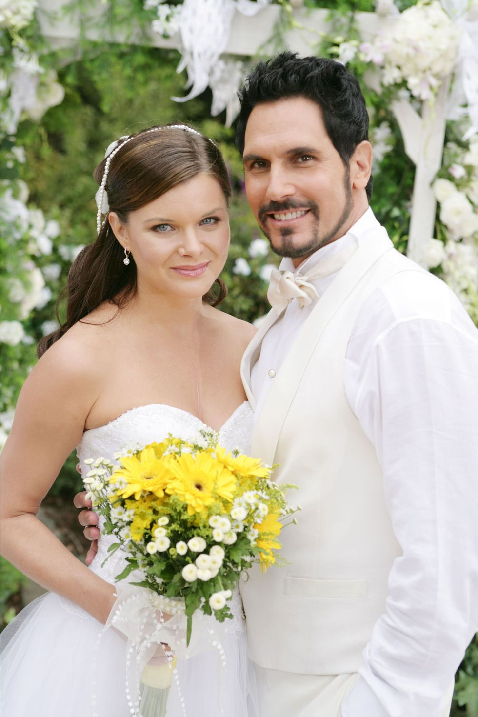 Heather Tom and Don Diamont in TV wedding for a soap opera.
