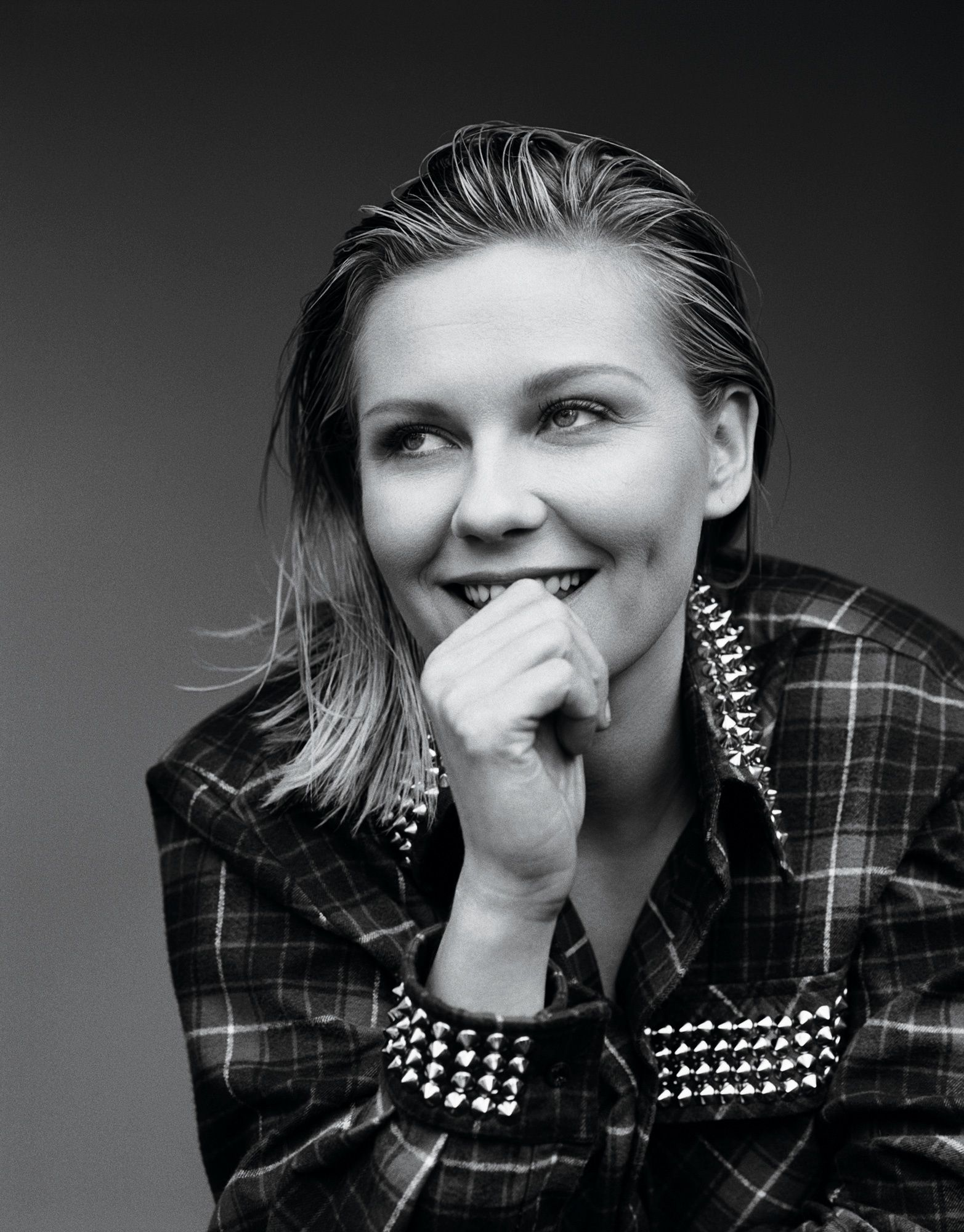 Black and white portrait of Kirsten Dunst.