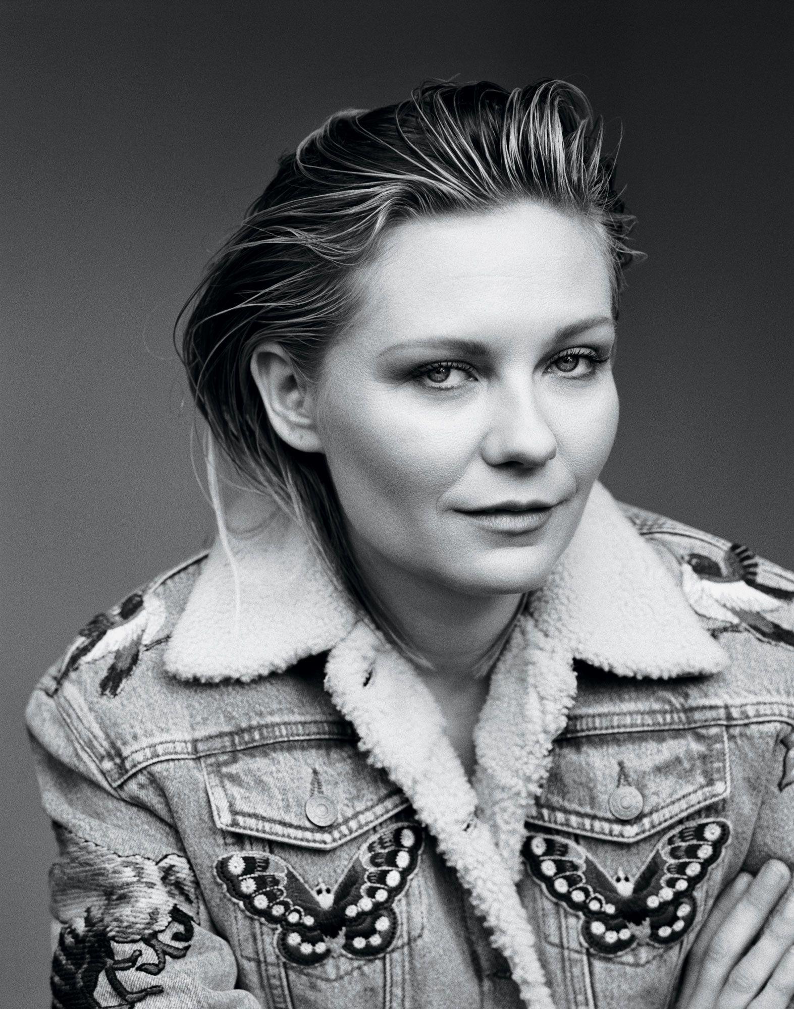 Black and white portrait of Kirsten Dunst in denim jacket.