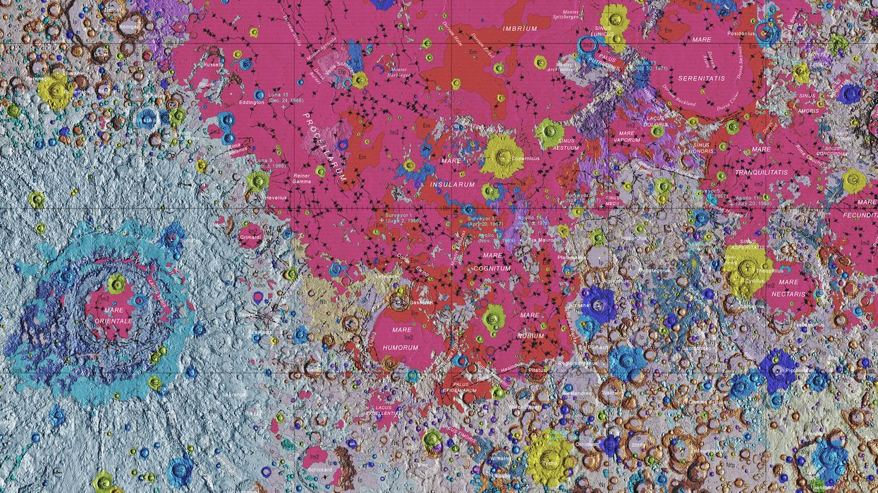 Impact craters in different colors give the lunar surface the look and feel of an action painting à la Jackson Pollock.