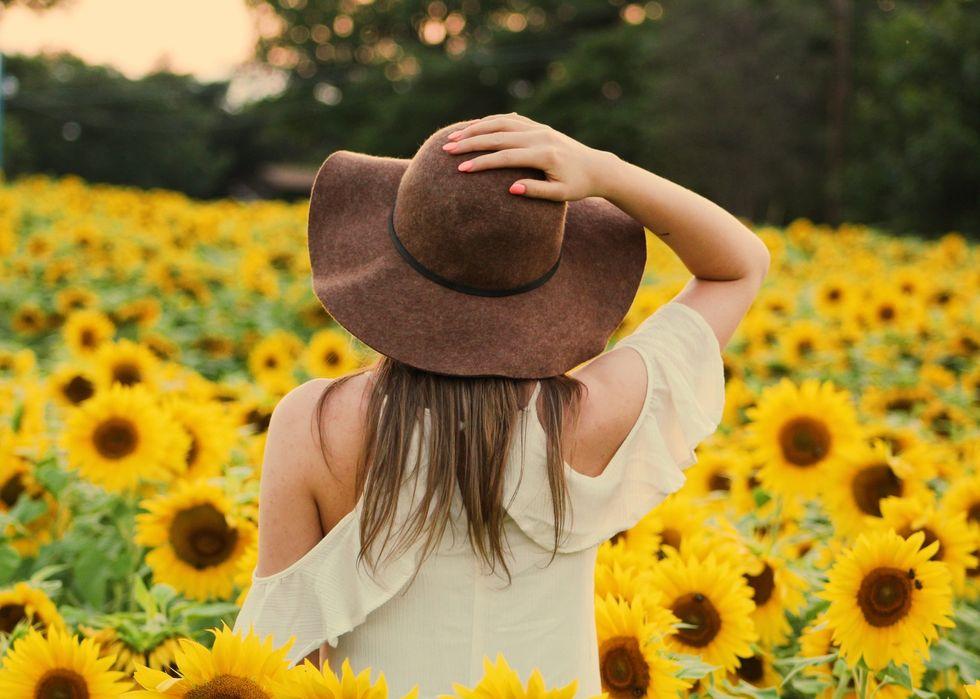 https://www.pexels.com/photo/photo-of-woman-in-a-sunflower-field-906002/