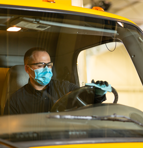 Penske associate sanitizing interior of truck