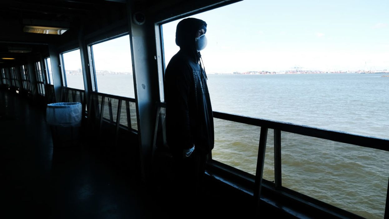 man looking out from Staten Island Ferry