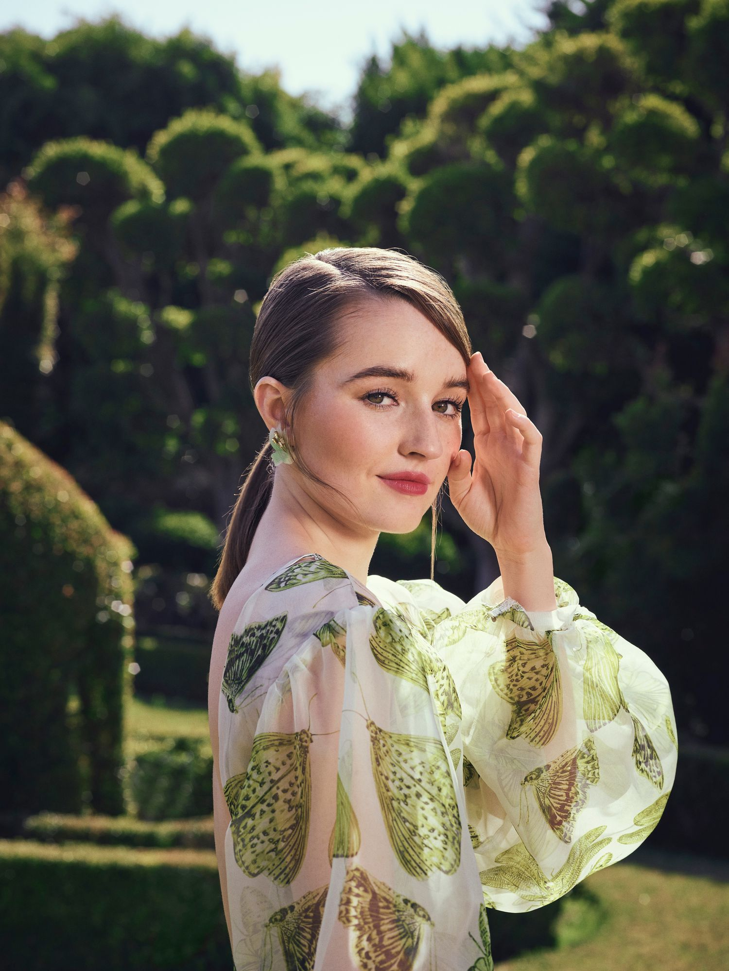 Kaitlyn Dever in butterfly print dress.