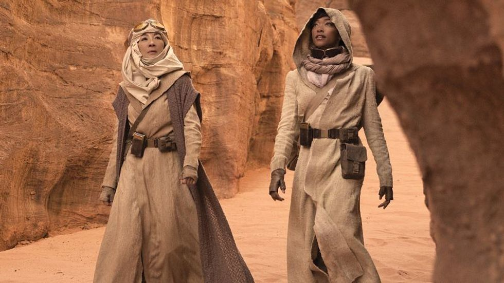 Michelle Yeoh to the left and Sonequa Martin Green on the right in Star Trek Discovery wearing long tan outfits on a rocky set