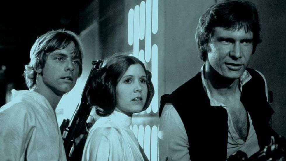 Mark Hamill Carrie Fisher and Harrison Ford in costume for Star Wars