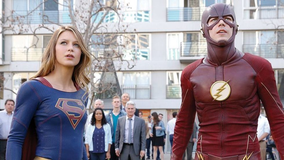 Melissa Benoist as Supergirl and Grant Gustin as The Flash looking up and off into the distance