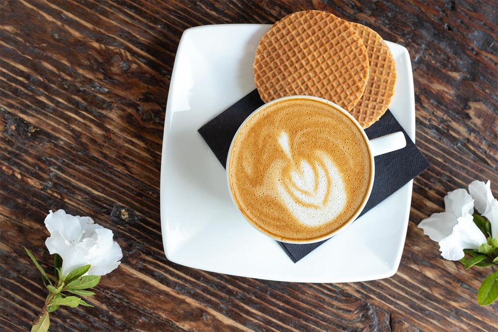 A Daelmans Stroopwafel with a cup of coffee