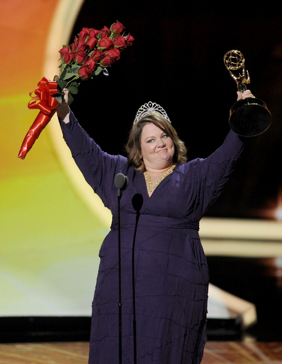 Melissa McCarthy onstage accepting Emmy award for Mike & Molly.