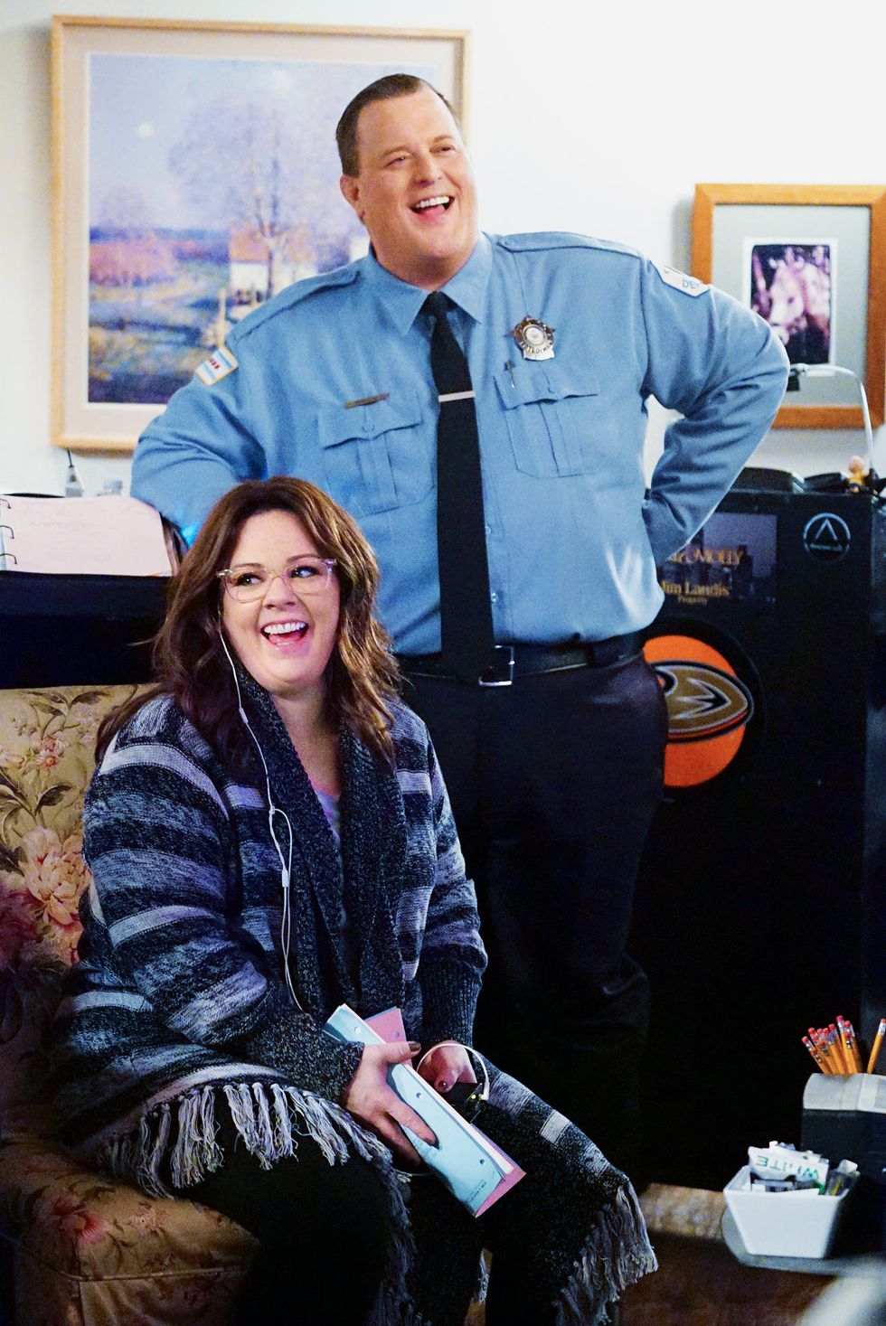 Billy Gardell and Melissa McCarthy laugh in a candid shot taken backstage at a rehearsal.
