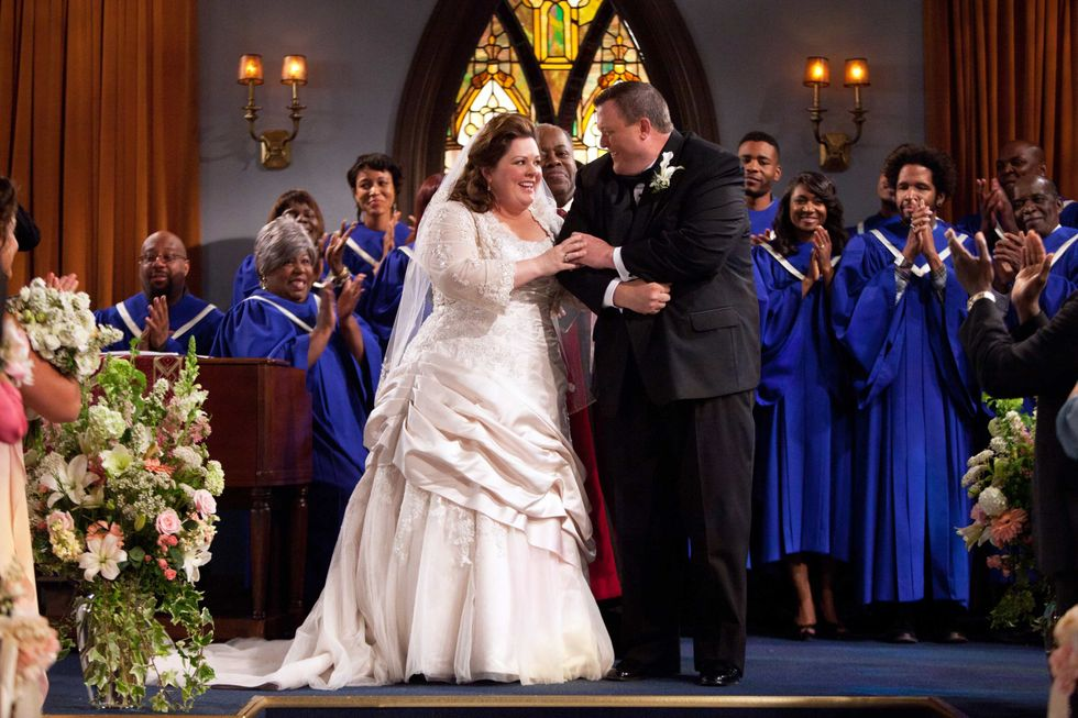 Billy Gardell and Melissa McCarthy dressed as bride and groom.