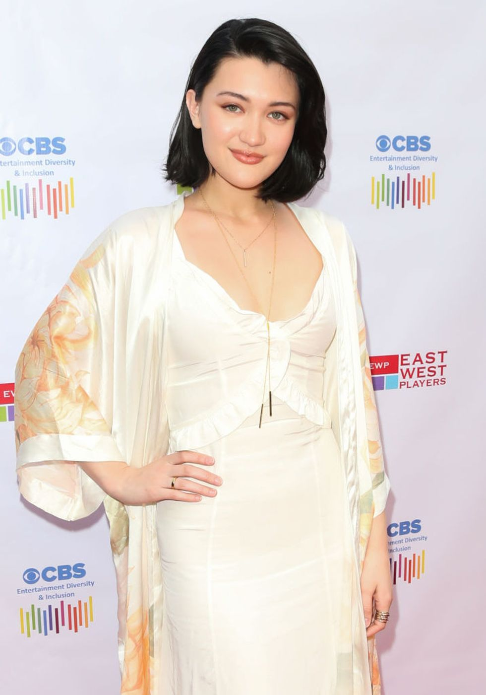 Actress Isa Briones in a yellow silk dress at a CBS Entertainment, Diversity & Inclusion event.