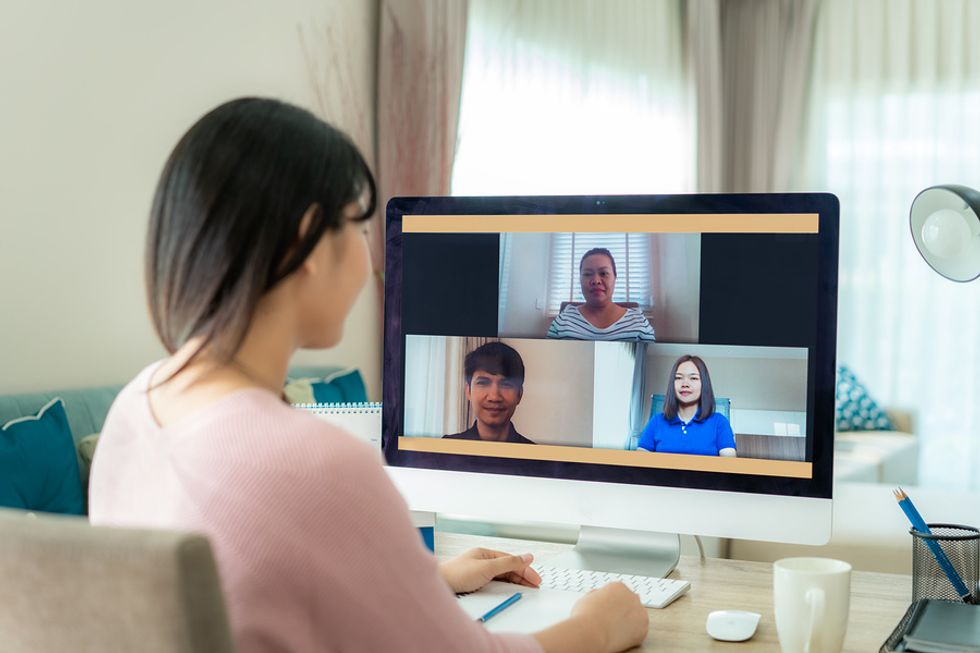 Remote worker has a daily meeting with her co-workers.