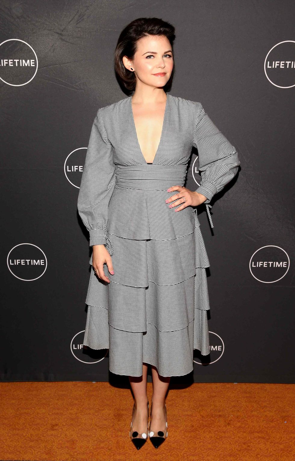 Ginnifer Goodwin in a gray designer dress.