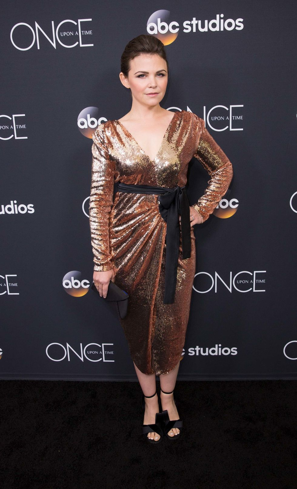Ginnifer Goodwin in a sparkly gold dress.