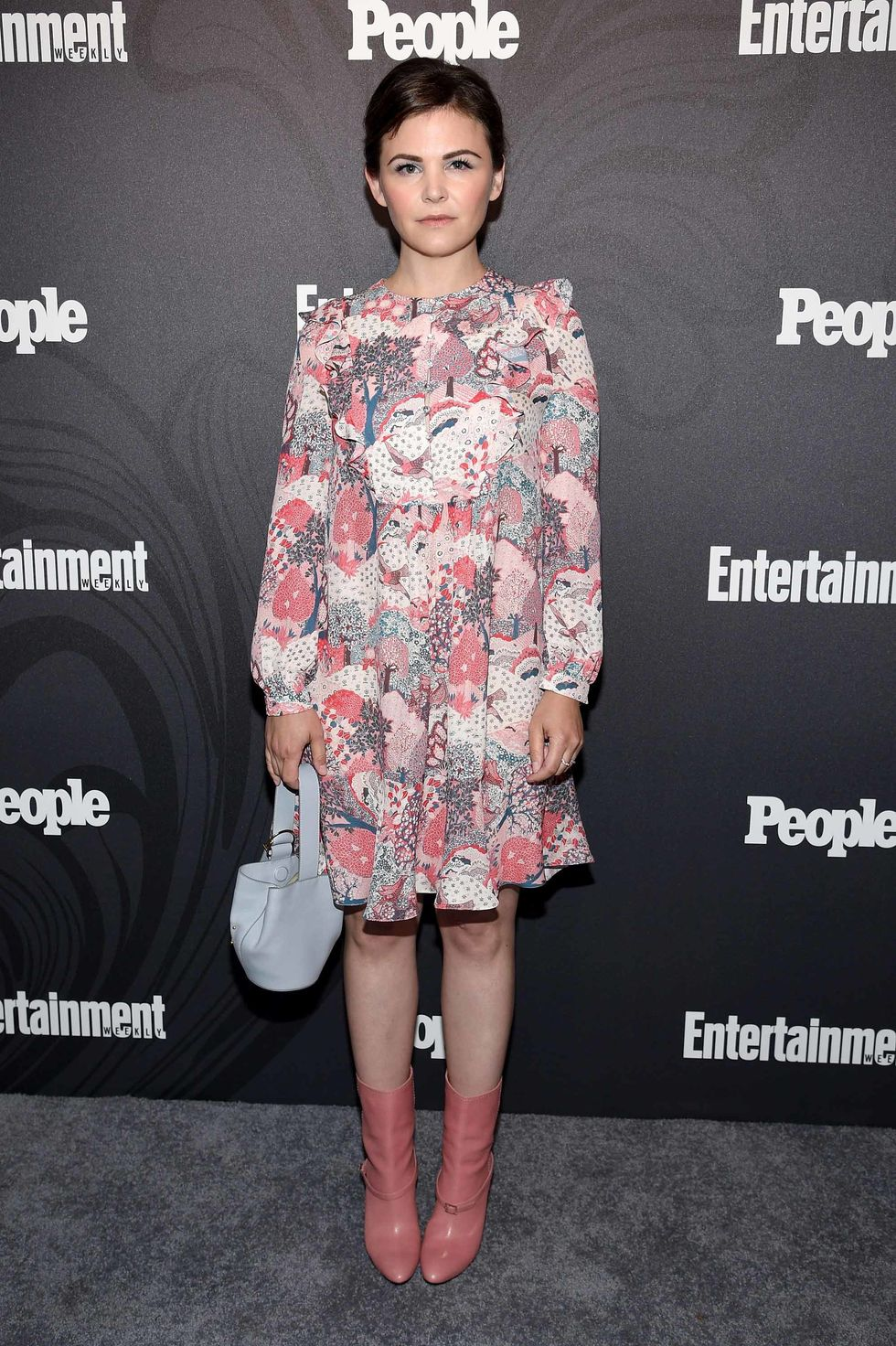 Ginnifer Goodwin in a short print dress and pink boots.