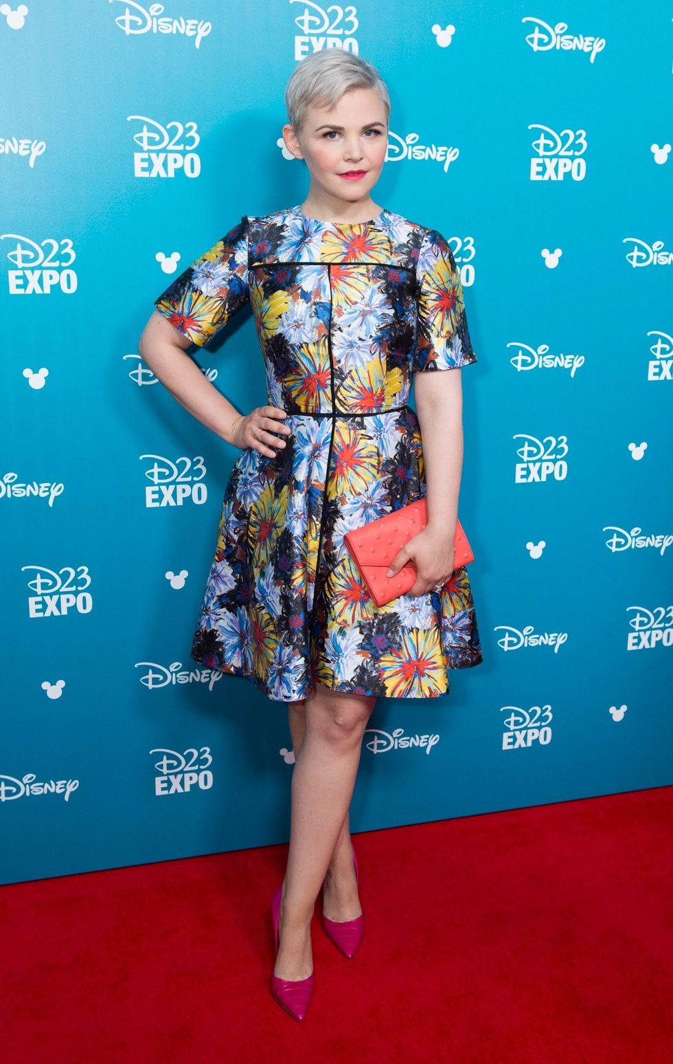 Ginnifer Goodwin in a short floral dress and pink heels.