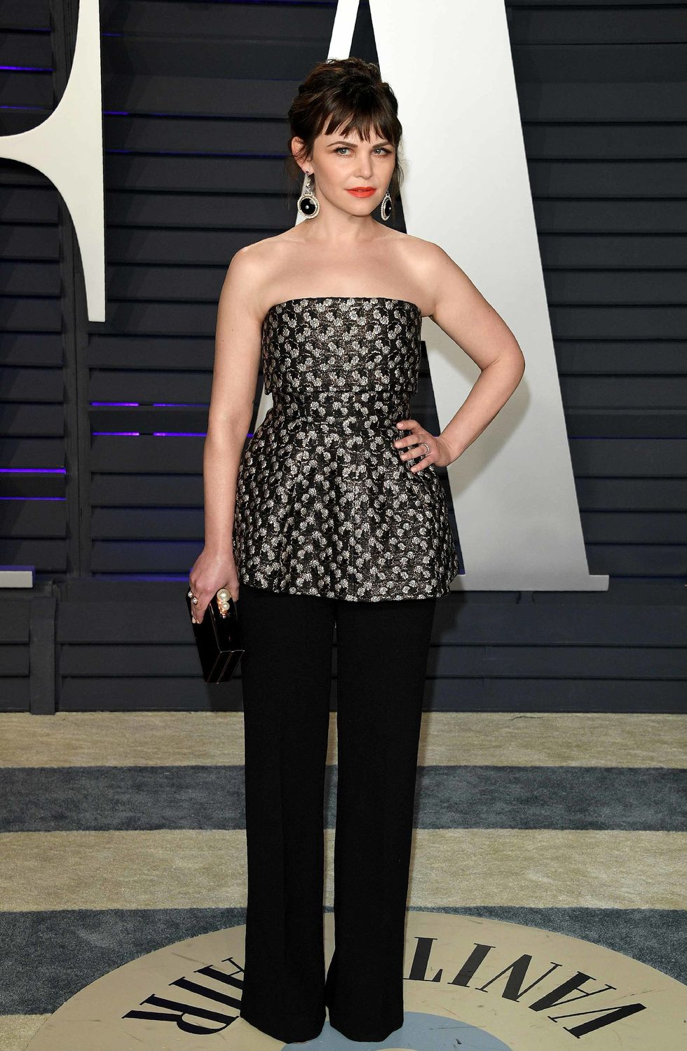 Ginnifer Goodwin in a strapless top and black pants.