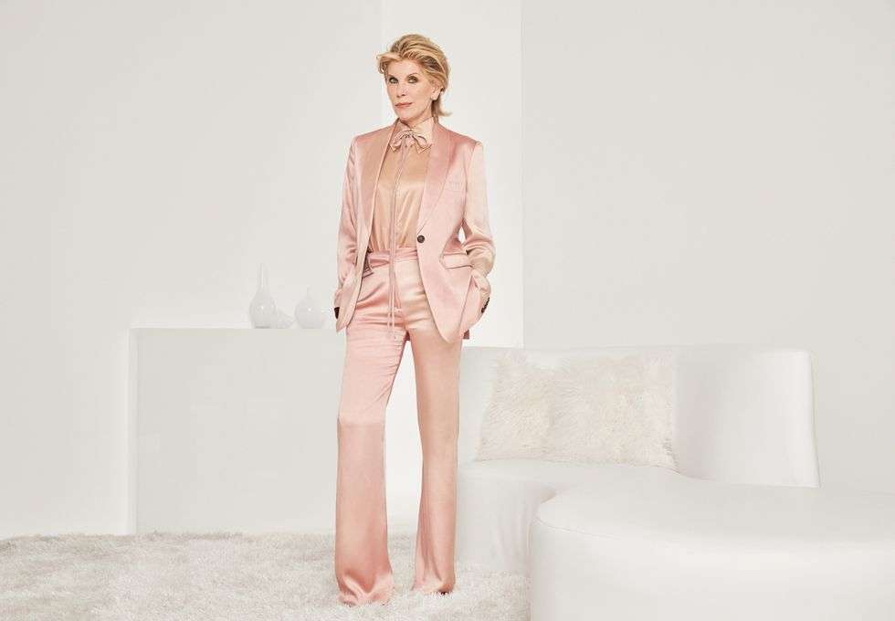 Christine Baranski in a pink silk power suit.