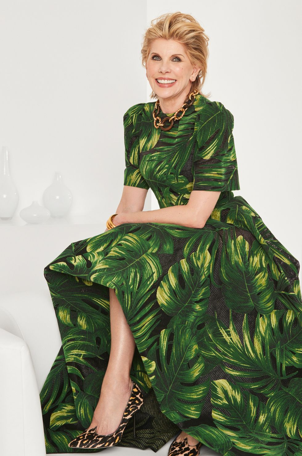 Christine Baranski in a palm leaf print gown.