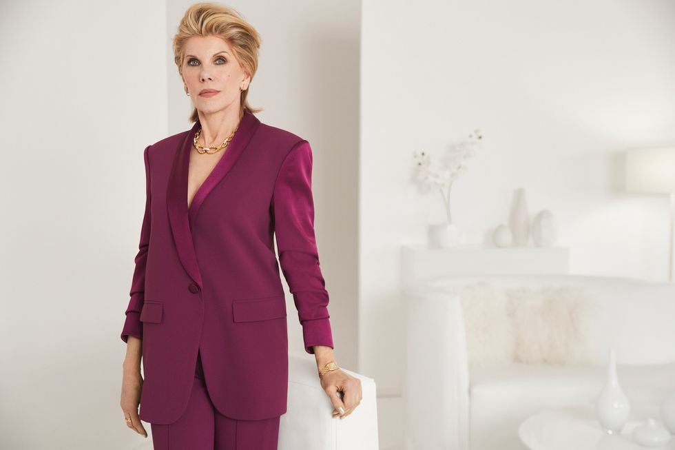 Christine Baranski in a wine-colored power suit.