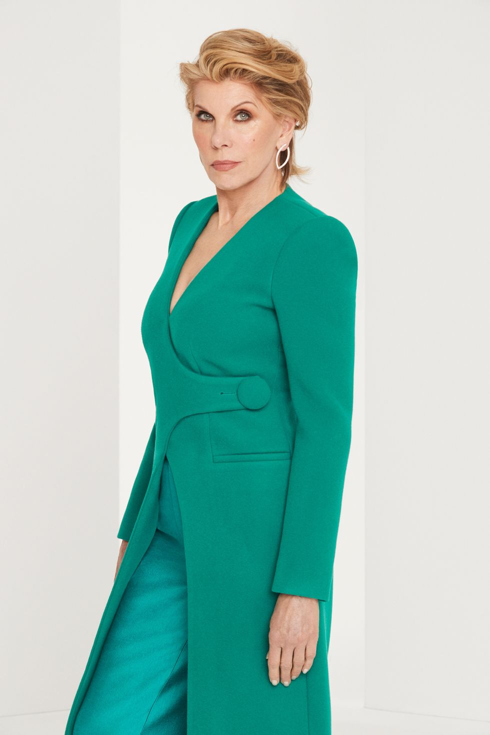Christine Baranski in a green power suit.