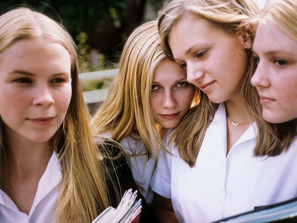 Still image of a teenage Kirsten Dunst and castmates from the movie The Virgin Suicides.