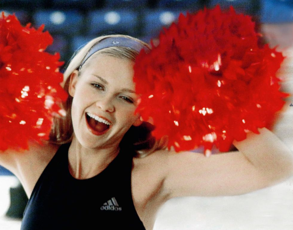 Kirsten Dunst in her cheerleader clothing from the movie Bring It On.
