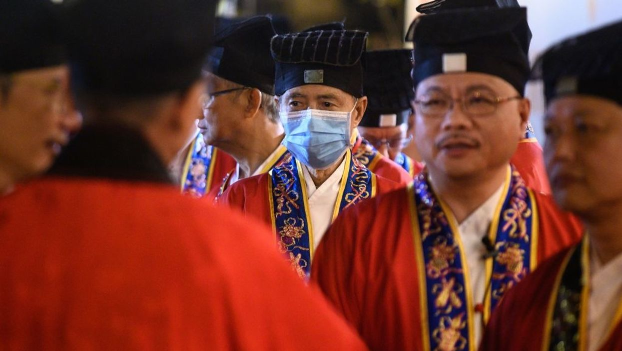 Taoist priest wearing face mask