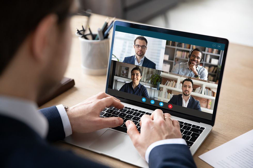 Business professionals take part in an online networking event.