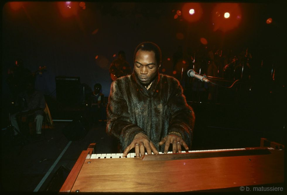 Fela Kuti at a piano