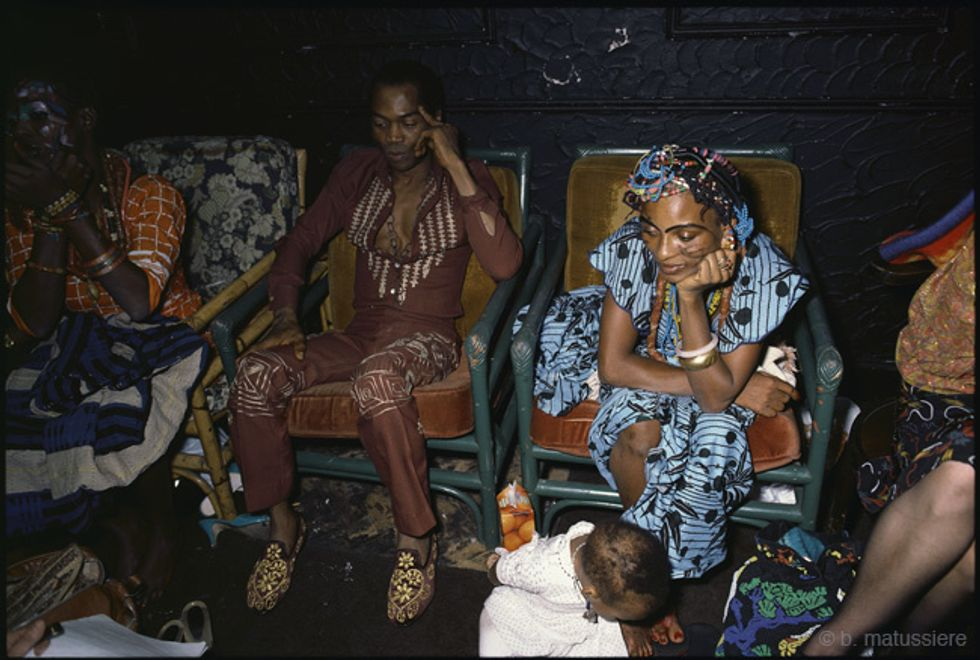 Fela Kuti sits with the Kalakuta Queens.