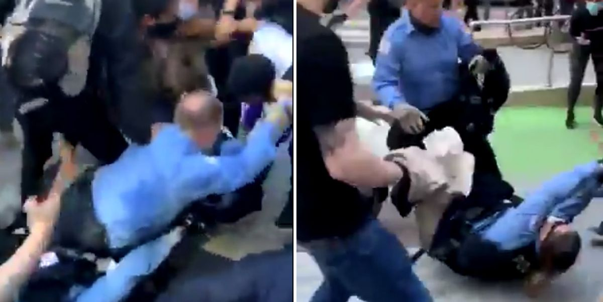 Shocking video shows violent protesters drag Chicago police officers through street