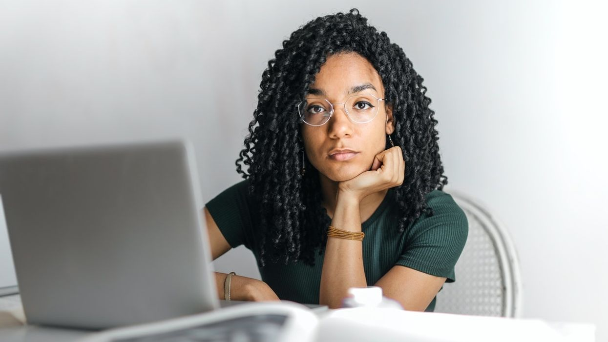 woman sitting at desk with laptop