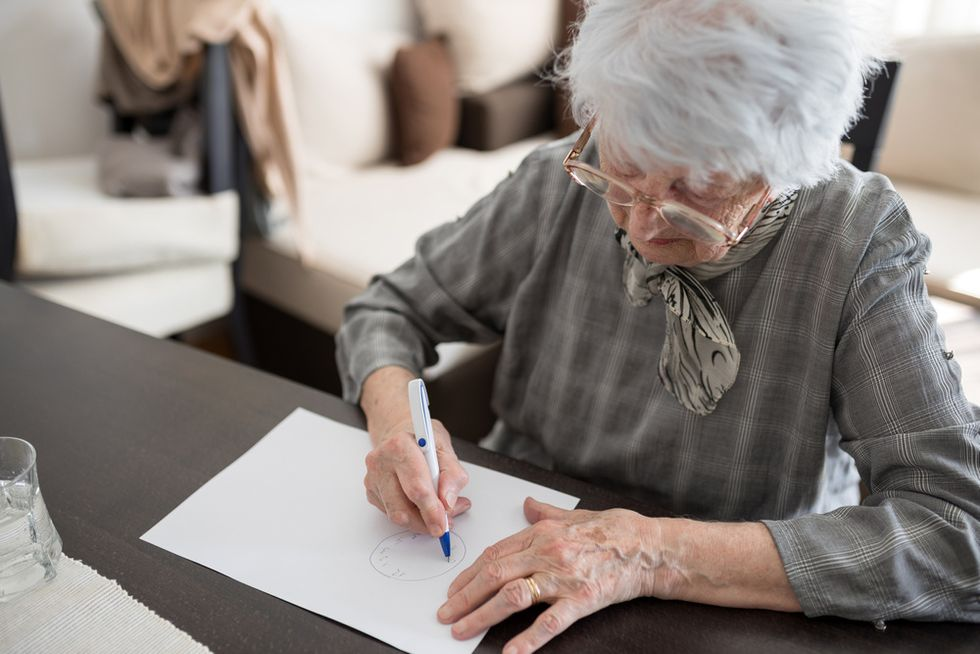 old women drawing concept of cognitive ability in older women