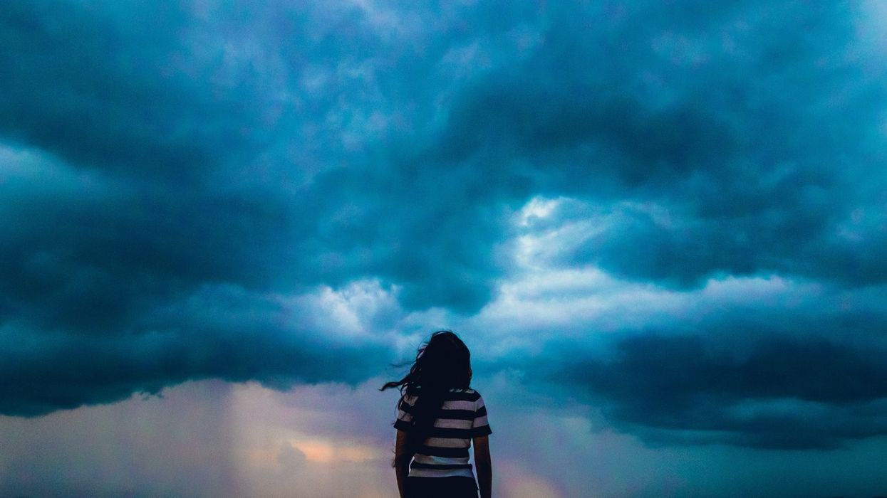 woman watching storm come in